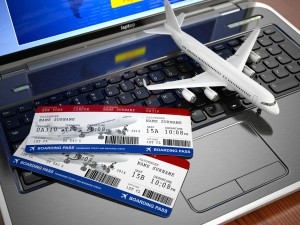 Online ticket booking. Airplane and boarding pass on laptop keyboard. 3d